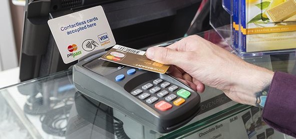 Card being swiped in a contactless payment