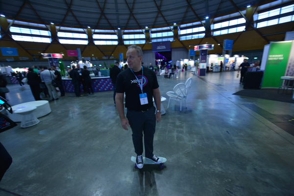 Rod Drury skateboarding around at Xerocon Australia