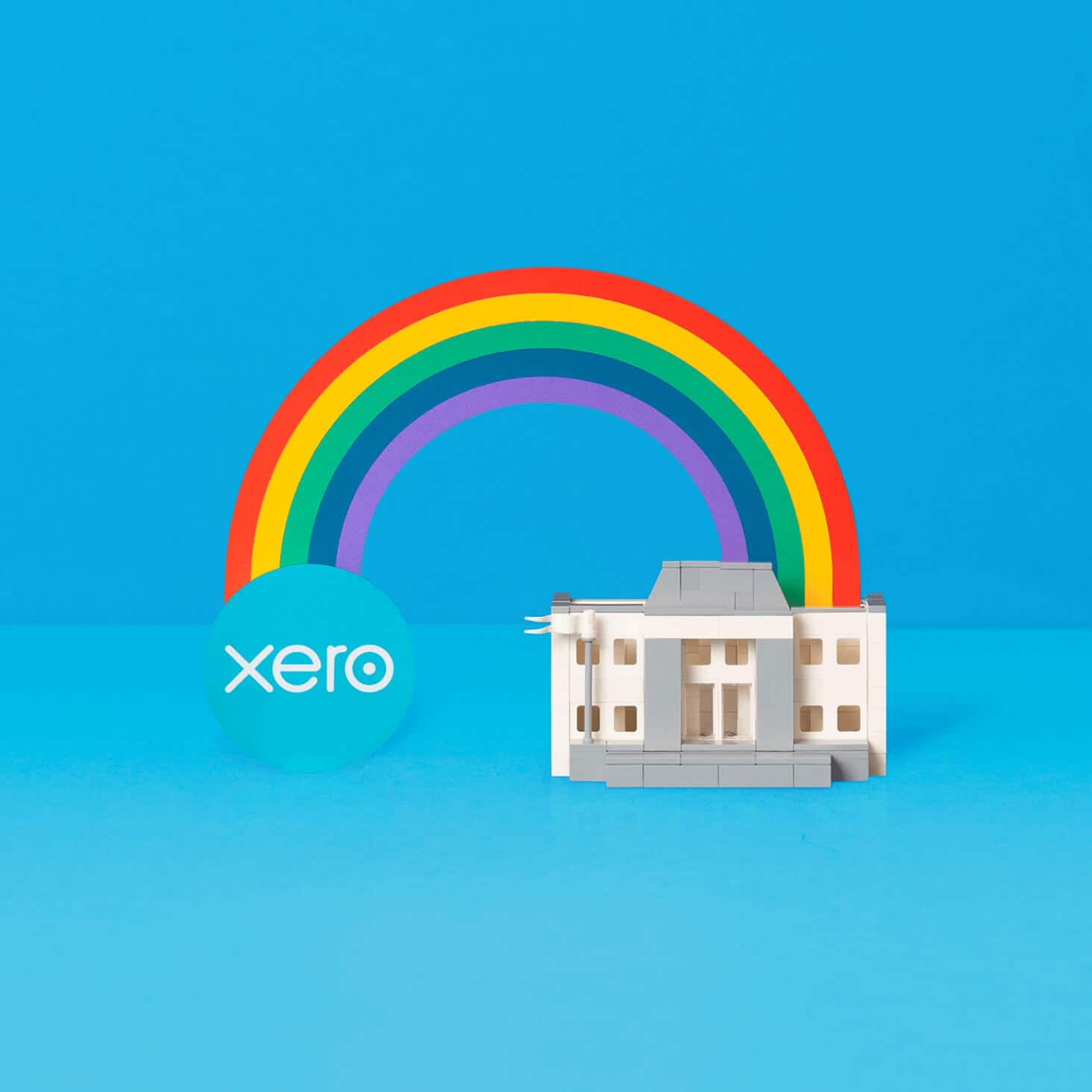 Xero logo connected to a bank by a rainbow