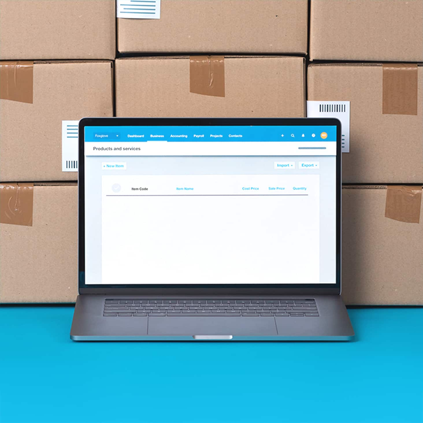 Unopened boxes containing new stock are stacked near a laptop that displays a list of inventory items in Xero.