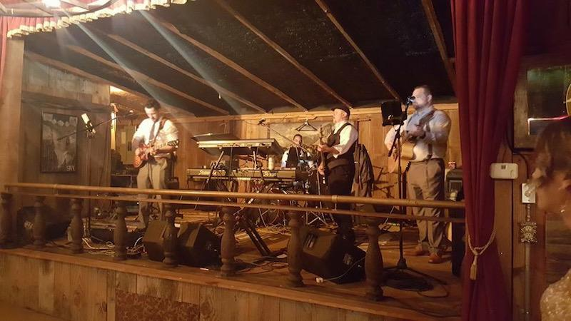 Tate and his band playing at a friend's wedding