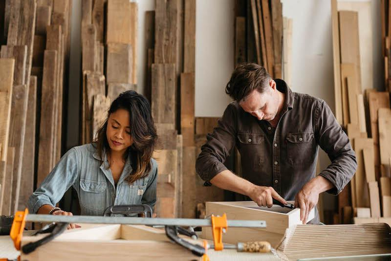 Claire and her husband, Aaron, doing woodwork in their workshop