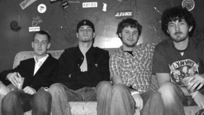 Tate Henshaw with three band members at university