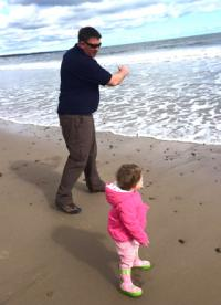 Stephen skims stones watched by daughter Lucy at Amble