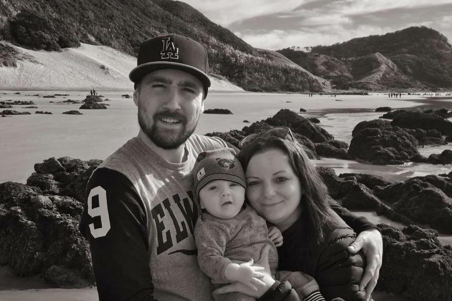 Joanne, her husband Justyn and son Connor on the beach